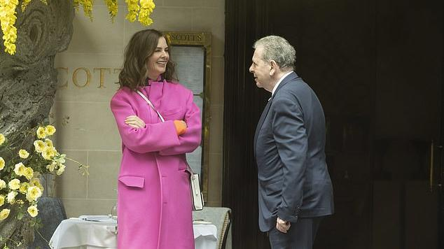 Picture for Trinny Woodall, 57, brightens up rainy London in all-pink ensemble as she enjoys loved-up lunch with Charles Saatchi, 77, at Scott's in Mayfair