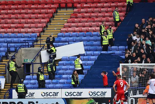 Picture for Wigan beat Bolton 4-0 but derby clash is overshadowed by crowd trouble with missiles thrown