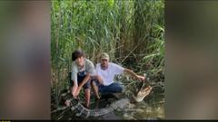 Cover for Maryland Man Catches 7.5 Foot Alligator Near Chesapeake Bay