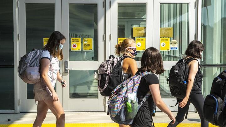 Cover for Iowa focuses on masks as coronavirus deaths rise