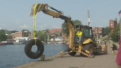 Cover for Diving Club removes tons of debris from Lake Superior in Marquette's Lower Harbor