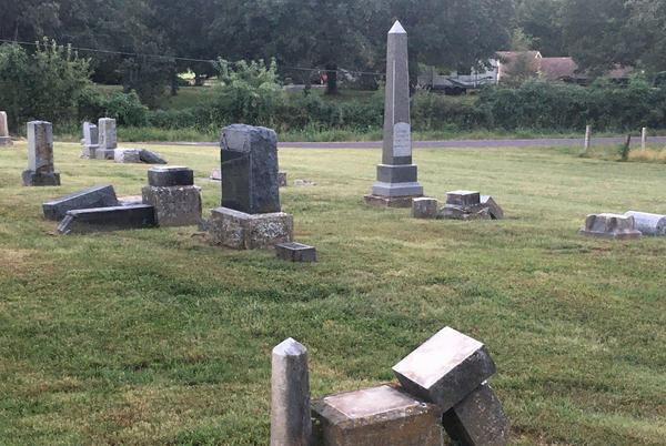 Picture for Gravestones knocked over in old Jackson County cemetery