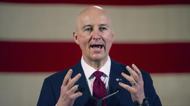 Cover for Nebraska to report more virus stats as hospitalizations rise