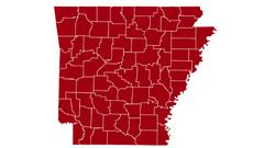 Cover for COVID-19 transmission levels in Arkansas by county