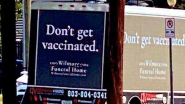 Cover for A funeral home truck in North Carolina is telling future customers not to get vaccinated