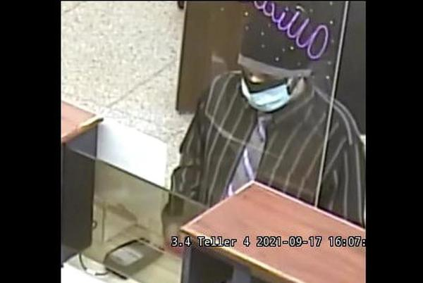 Picture for Man wearing purple tie, surgical masks robs Chase Bank in DeWitt, police say