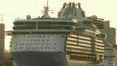 Cover for Passengers prepare to board Royal Caribbean's Allure of the Seas for test voyage