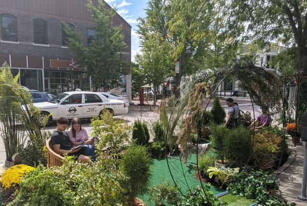 Picture for Students set up small parks in parking spots in downtown Ames for Park(ing) Day