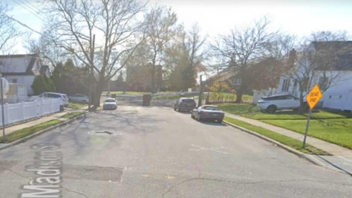 Cover for Suspect At Large After Man Shot, Killed In Broad Daylight On Residential Long Island Street