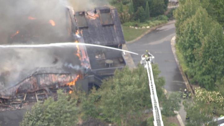 Cover for 16 fire departments respond to 'very active fire' in Setauket
