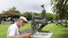 Cover for 'Fisherman' statue relocated in Hilo park