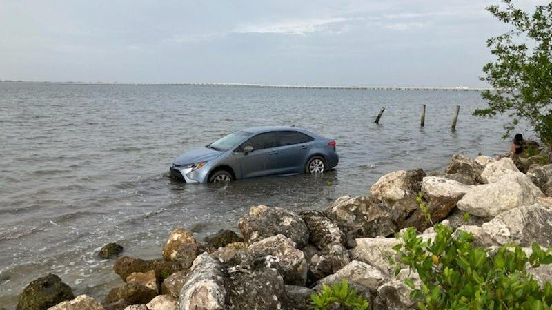 Picture for Car parked illegally on Florida beach flooded by high tide