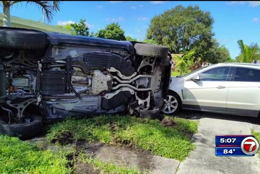Picture for 4 in custody after stolen Jeep slams into tree, rolls over outside Lauderhill home