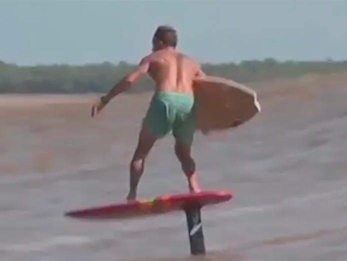 and-now-a-foil-to-surfboard-transfer-on-a-tidal-bore
