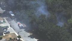 Cover for Crews battling brush fire in San Jose, officials say
