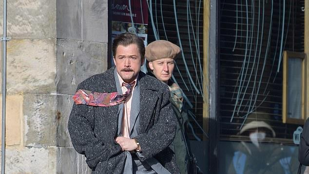 Picture for Taron Egerton transforms into game developer Henk Rogers as he hails a taxi while shooting new scenes for film Tetris in Glasgow