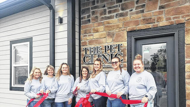 Cover for Pet Clinic holds ribbon cutting