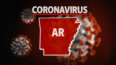 Cover for COVID-19 in Arkansas: Hospitalizations surge over 1,000 patients, more than 2,000 new cases reported