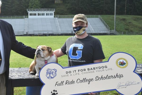Picture for Gov. Justice presents full-ride college scholarship to young staff member at Greenbrier West High School