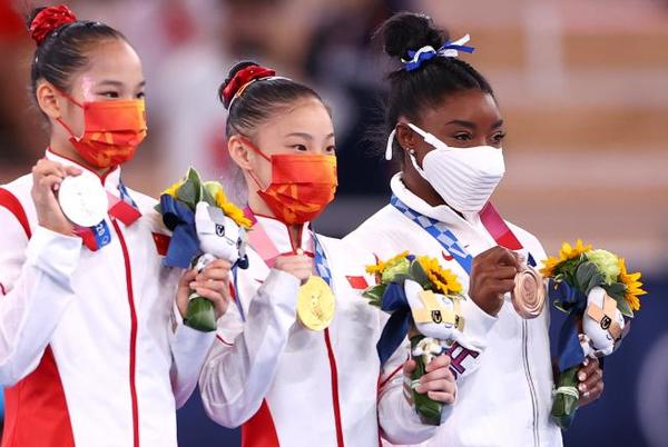 Picture for Guan Chenchen wins balance beam gold at the Tokyo Olympics as Simone Biles claims bronze