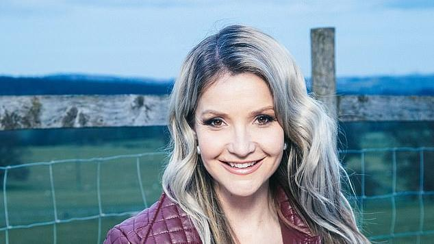 Picture for Helen Skelton sweetly cradles two lambs after helping to save a newborn animal's life during a VERY dramatic birth on Springtime on the Farm