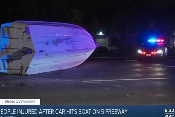 Picture for 3 hospitalized after car crashes into boat on I-5 in Chula Vista