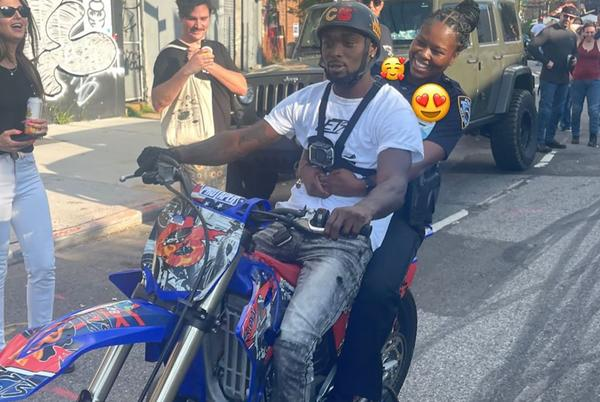 Picture for NYPD cop suspended after being filmed riding on back of dirt bike