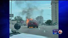 Cover for Mercedes catches fire near Miami intersection; no injuries