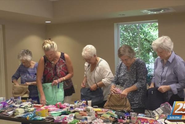 Picture for Packing purses to help ladies in Louisiana