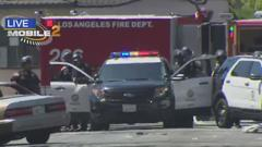 Cover for Gunman Barricaded In RV In South LA Escapes Police