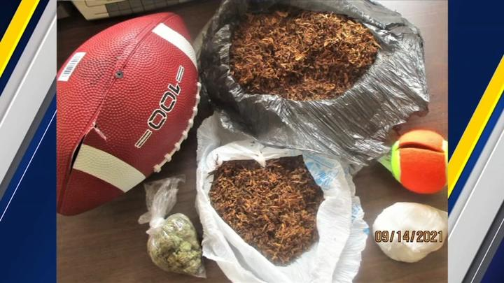 Cover for NC correctional officers find football full of drugs between prison fences