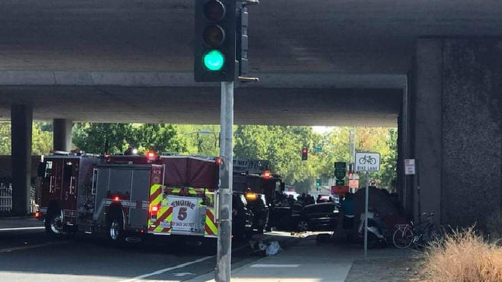 Cover for Car runs into homeless people camped under Sacramento overpass on T Street