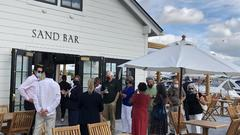 Cover for Sand Bar in Canandaigua reopens to public after limiting diners due to 'very high demand'