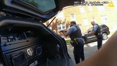 Cover for Video Shows Tense Moments of Police Shooting, With Cops Yelling to Stay Clear as They Fire Dozens of Rounds at Suspect