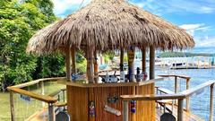 Cover for New Hampshire's Floating Tiki Huts Are a Bucket List Must This Summer