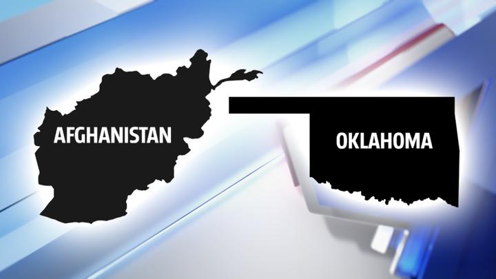 Cover for First Afghan refugees arrive in Oklahoma