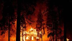 Cover for California's largest wildfire is threatening thousands of structures
