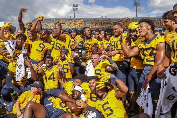 Picture for West Virginia holds off No. 15 Virginia Tech with goal line stand to win the Black Diamond Trophy