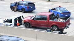 Cover for State police close WB I-696 near Woodward for 'road rage' investigation