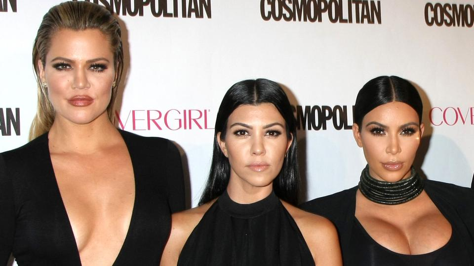 Picture for Khloe Kardashian says she was given fewer options than Kim and Kourtney at photo shoots because stylists thought she'd 'be in the background anyway'