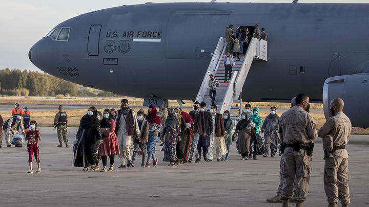 Cover for First Afghan Refugees Arrive In Massachusetts