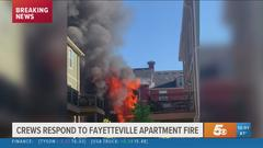 Cover for Two pets killed in massive Fayetteville townhouse fire, one person injured