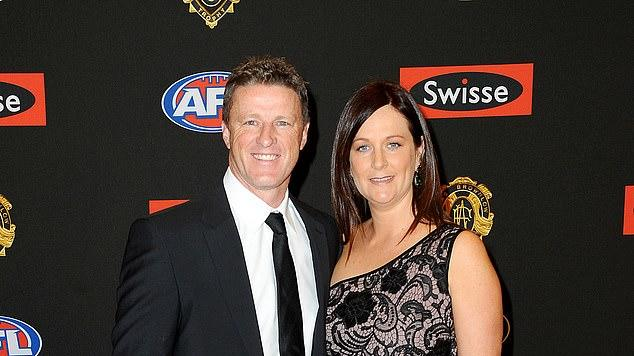 Picture for AFL premiership-winning coach Damien Hardwick goes public with his new romance after splitting from his wife of 30 years to be with a younger club staffer - as they step out in matching outfits