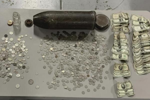 Picture for TORPEDO TREASURE: Coins from the 1800s found inside WWI bomb at Michigan home
