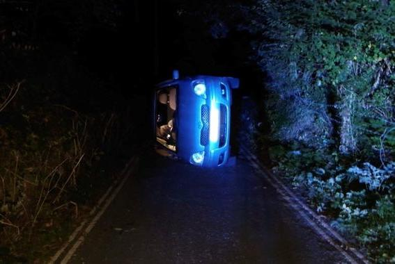 Picture for Derbyshire police rescue couple trapped in overturned car after 'strengthening their relationship'