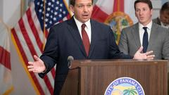 Cover for Florida Gov. DeSantis says he will 'stand in the way' of President Biden on COVID-19 restrictions