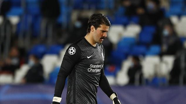 Picture for Simon Mignolet says Alisson's drop in form is because he is 'missing Virgil van Dijk' and adds that 'Liverpool with or without the defender is a huge difference'