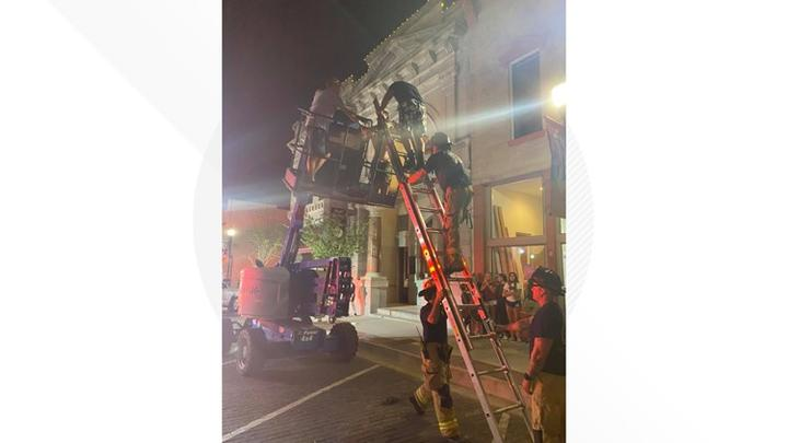 Cover for Rogers Fire Department on rescue scene after individuals get stuck on boom lift