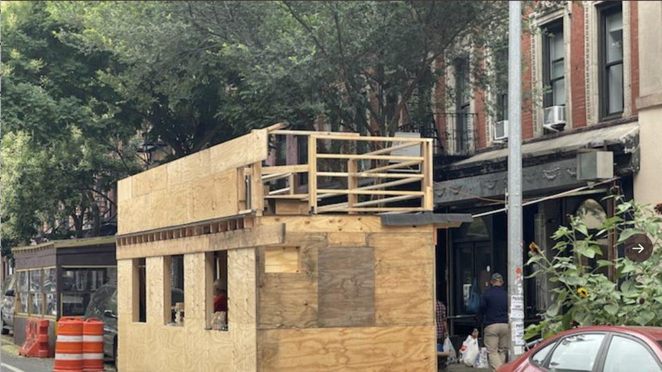 Picture for New York City restaurant ordered to stop building 2-story outdoor dining structure after locals complained