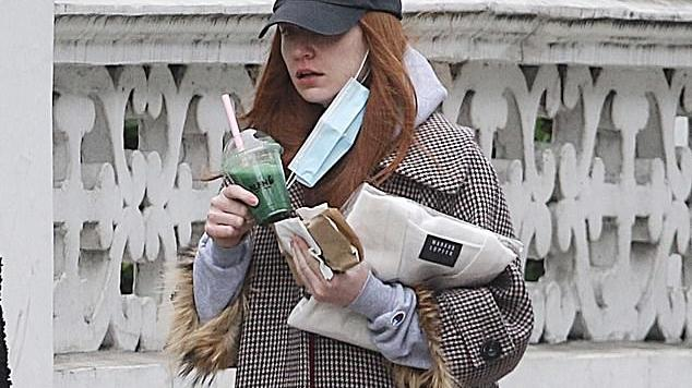 Picture for Nicola Roberts teams her comfy grey tracksuit with a stylish gingham coat as she heads out to grab a healthy green juice